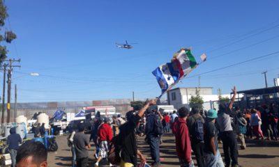 migrantes, muro, cruzar