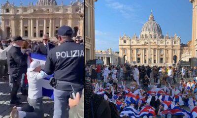 Cubanos protestan en el Vaticano tras el retiro de la bandera cubana a uno de sus compatriota
