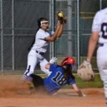 Klein Cain sophomore third baseman Emily Tran, center, finishes a play against Houston Christian baserunner Katie Hartwell (18) during the top of the third inning of their non-district matchup at KCHS on March 26, 2019.