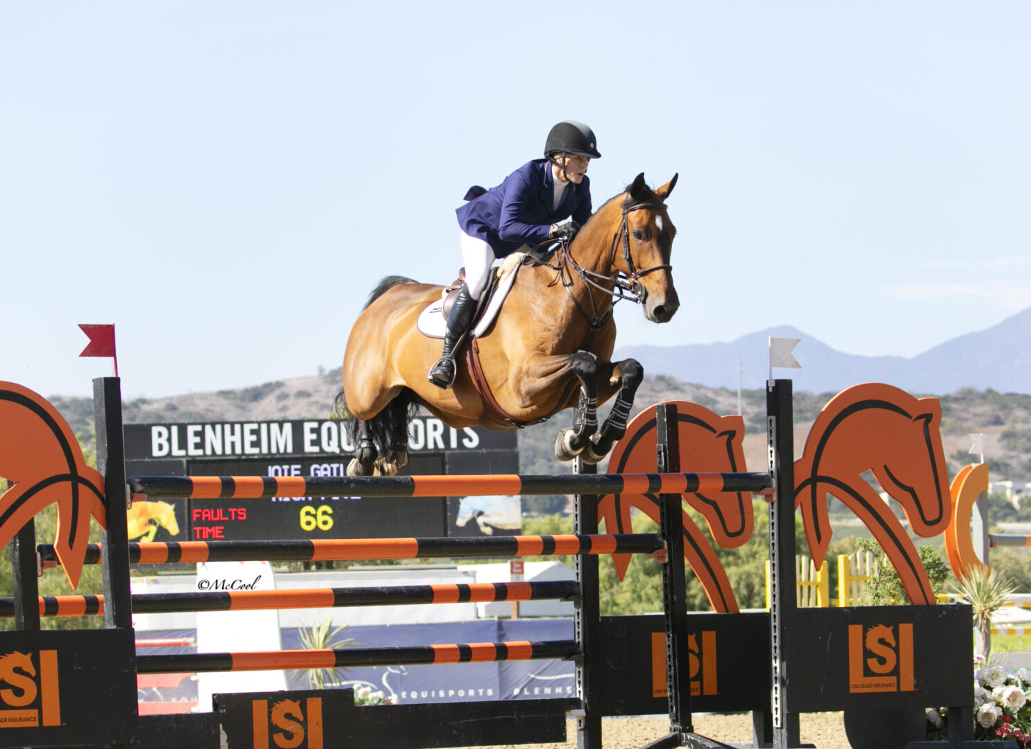 Nicole Haunert leads the victory gallop aboard Concolue