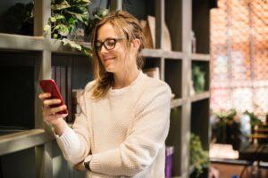 woman looking at phone smiling