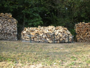 stored pile of odds and ends of split wood on wooden pallets