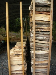 2 rows of firewood supported by 2x4's on the ends