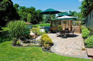 beautiful landscape with patio furniture ad wooden deck