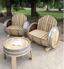 custom-made furniture made from barrel-like wood pieces located on outdoor patio