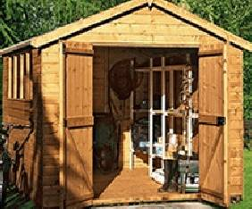 wooden shed with an A framed roof and 2 doors opened with items stored inside