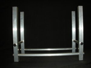 aluminum framed firewood holder with a black background