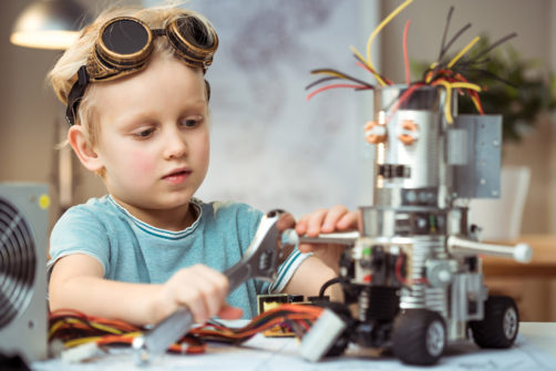 Little boy making robot