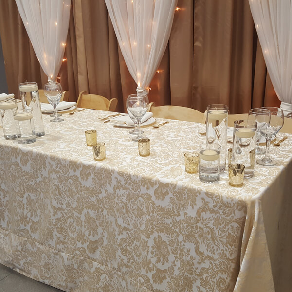 Champagne Damask Tablecloth | Celebrations by Rent-All located in Sioux Center | Wedding Rental | Tablecloths For Rent