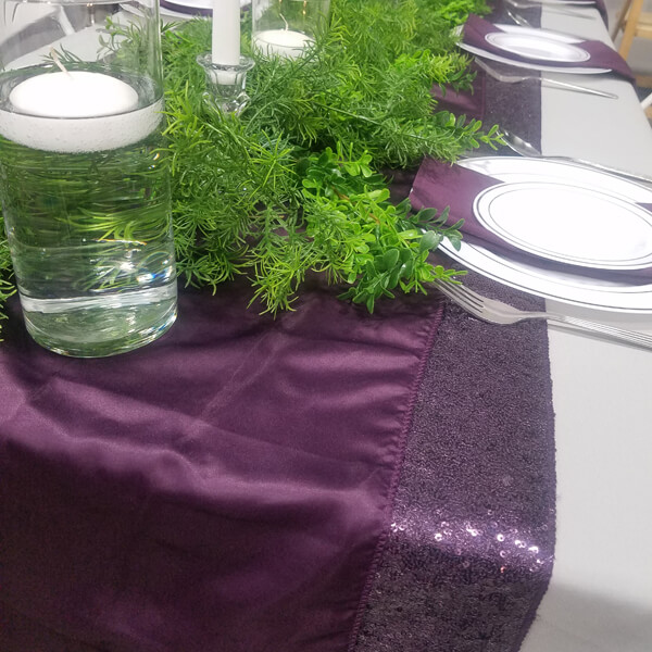 Plum Satin Runner | Celebrations by Rent-All located in Sioux Center | Wedding Rental | Table Runners For Rent