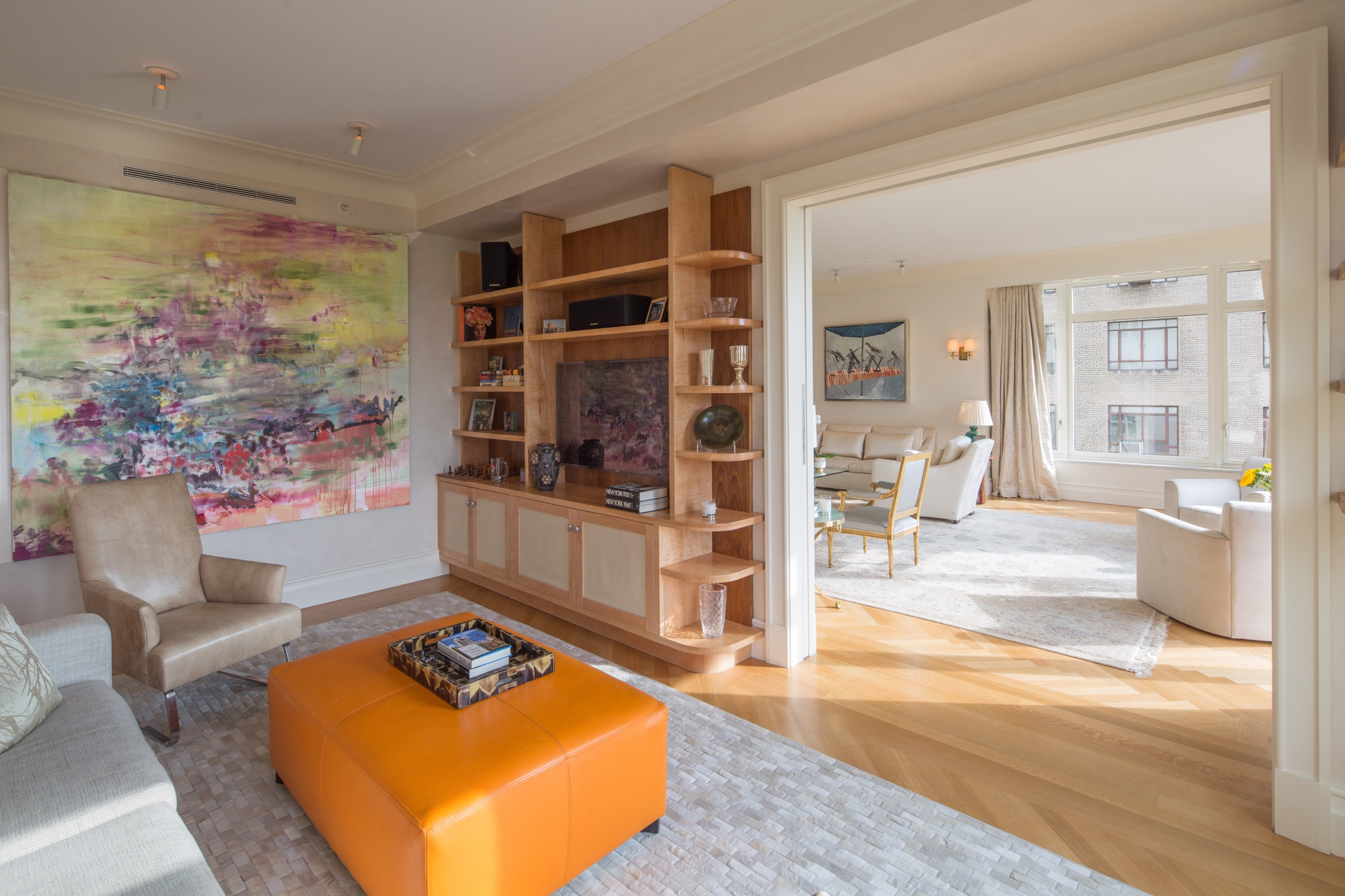 Custom furniture by Kevin Gray | Custom bookcases with two-tone woods, curved corners and raw silk fronts on lower cabinet