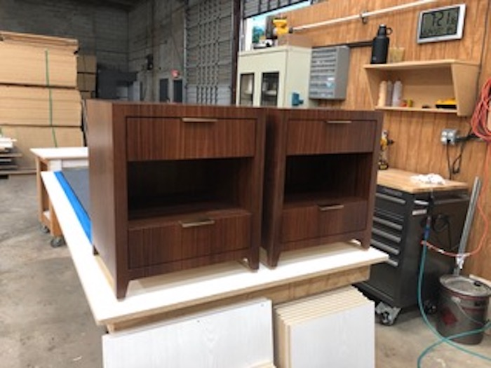 Custom nightstands in Indian rosewood and brushed brass edge pulls by Kevin Gray