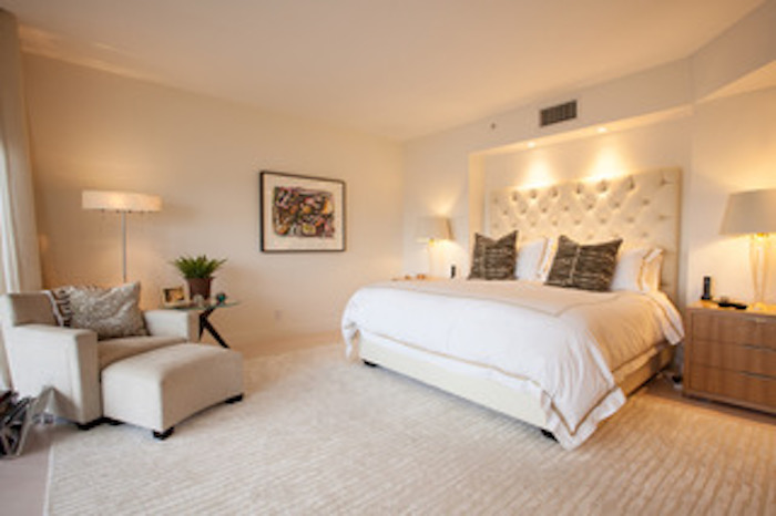Custom tufted king bed and base by Kevin Gray