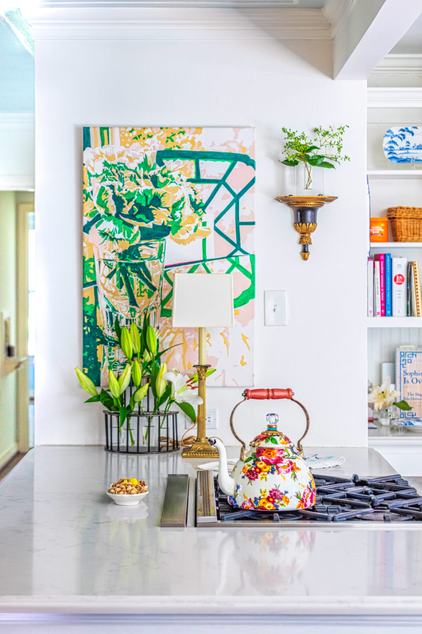 Susie Kwiatkowski's home tour captures her curated aesthetic perfectly. The kitchen is a blend of antiques with Susie's colorful, floral oil paintings.