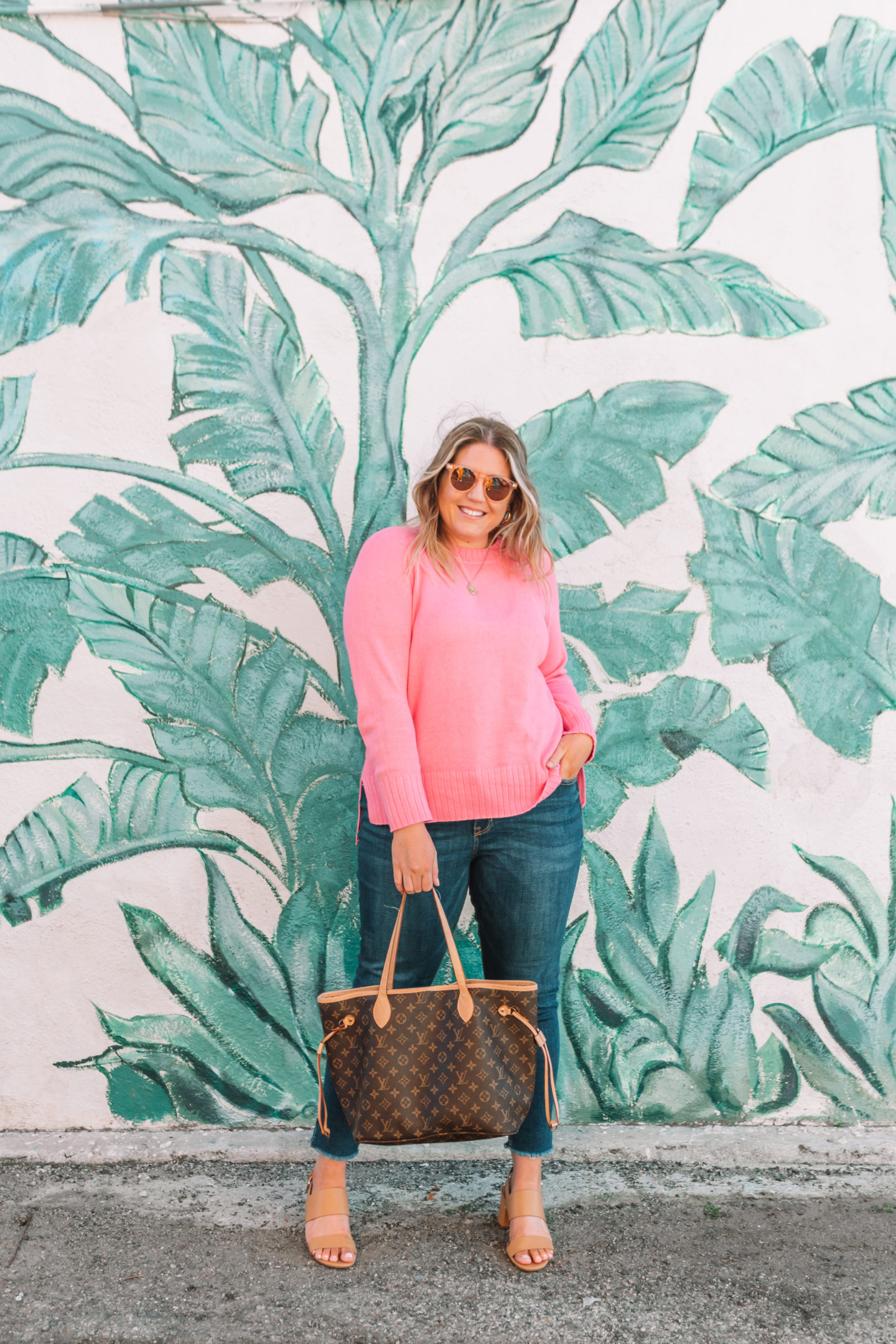 pink sweater, casual spring outfit, palm leaf wall venice beach
