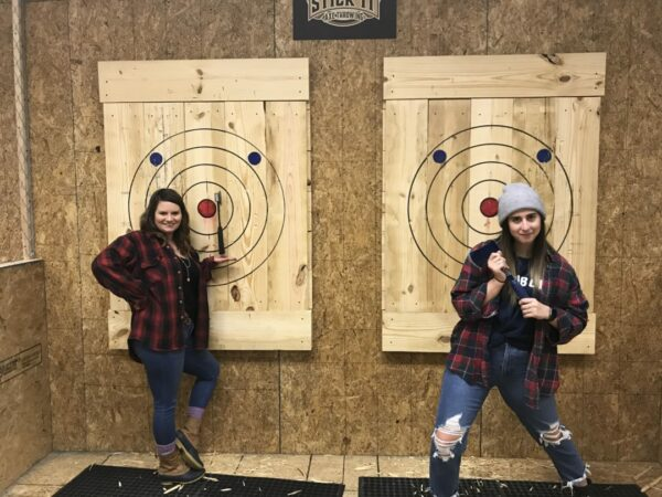 Tagtime Laser Tag's new axe throwing lanes.The Ladies are showing how its done with a perfect axe throw at Tagtime Laser Tag