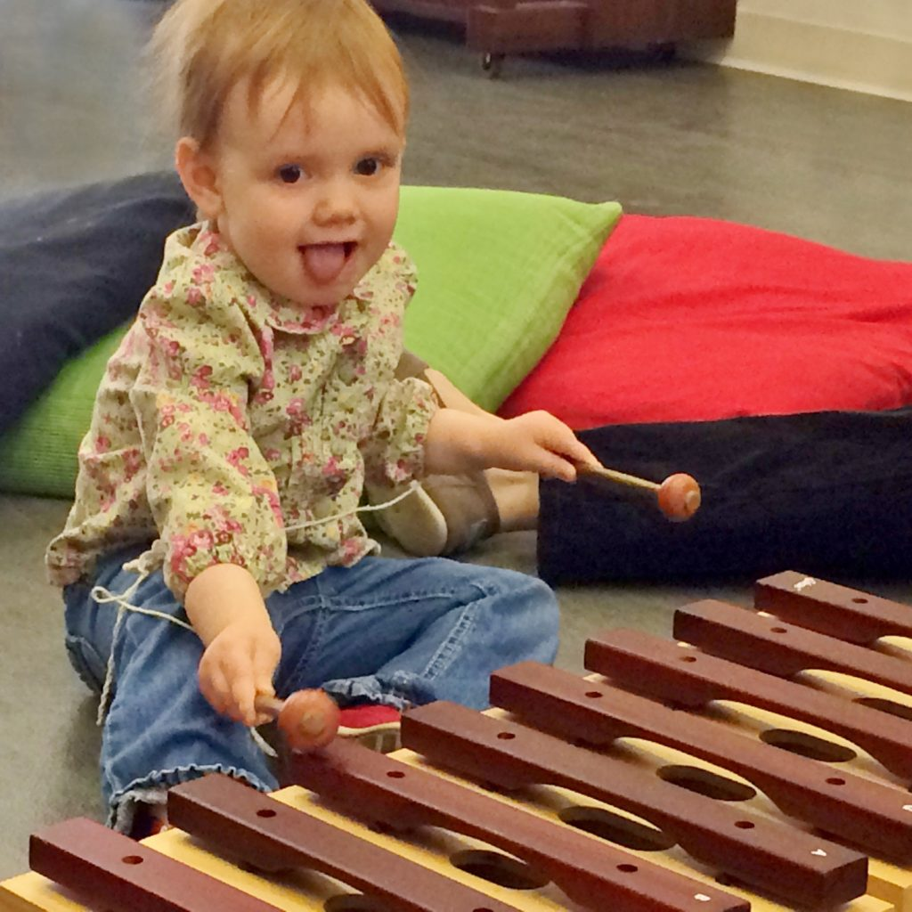 toddler playing marimba