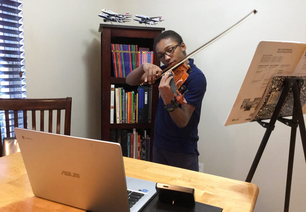 Student taking a remote violin lesson