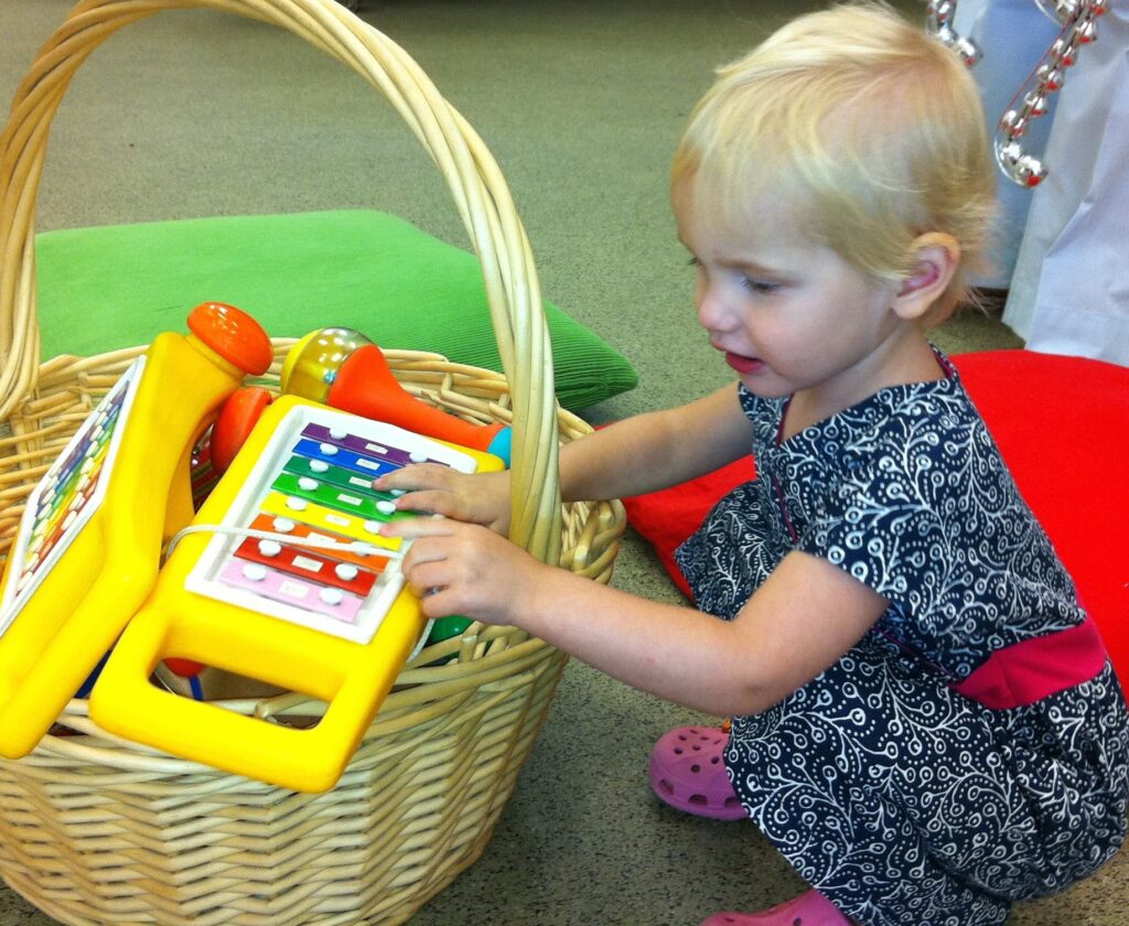 toddler with xylophone