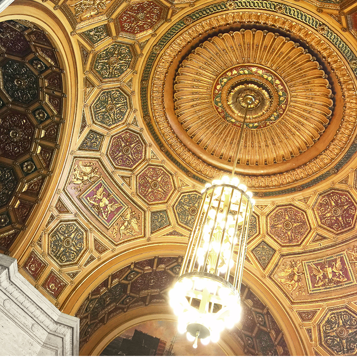 Gilt domed ceiling with tall chandelier