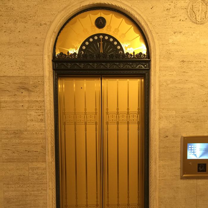 Gilt elevator doors