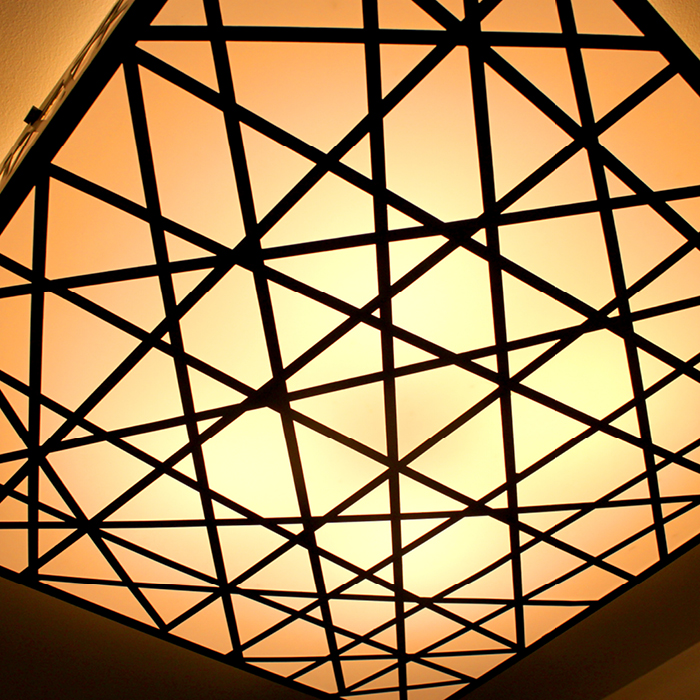 Cross-crossing decorative ceiling fixture