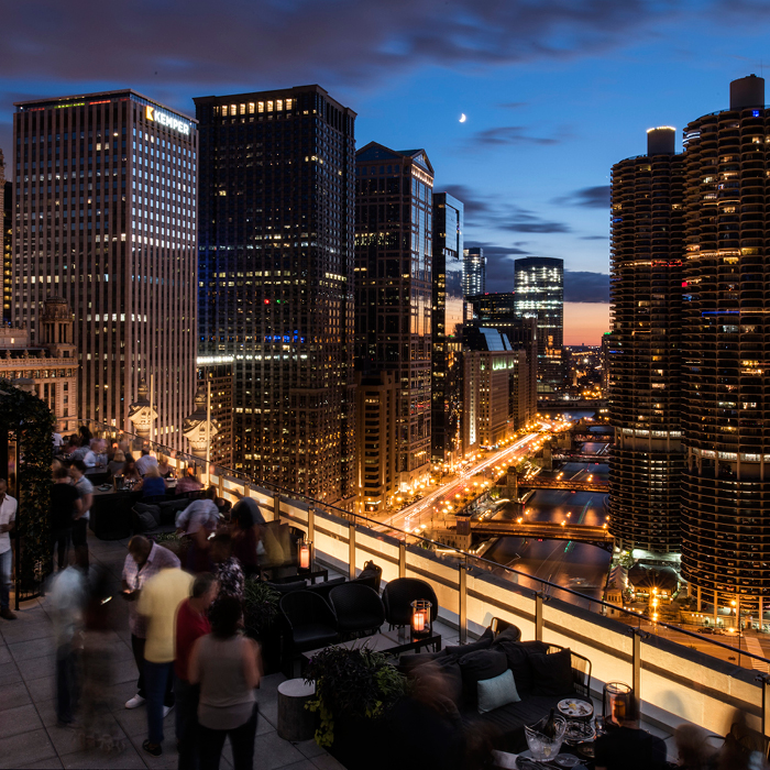 view off an outdoor balcony of cityscape at night