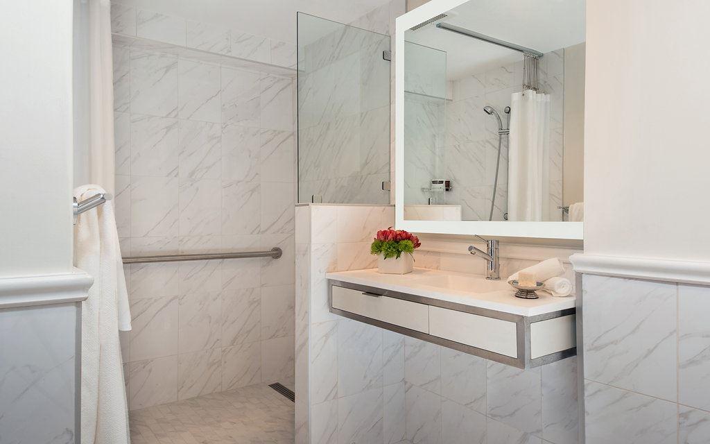 White marble-tiled bathroom