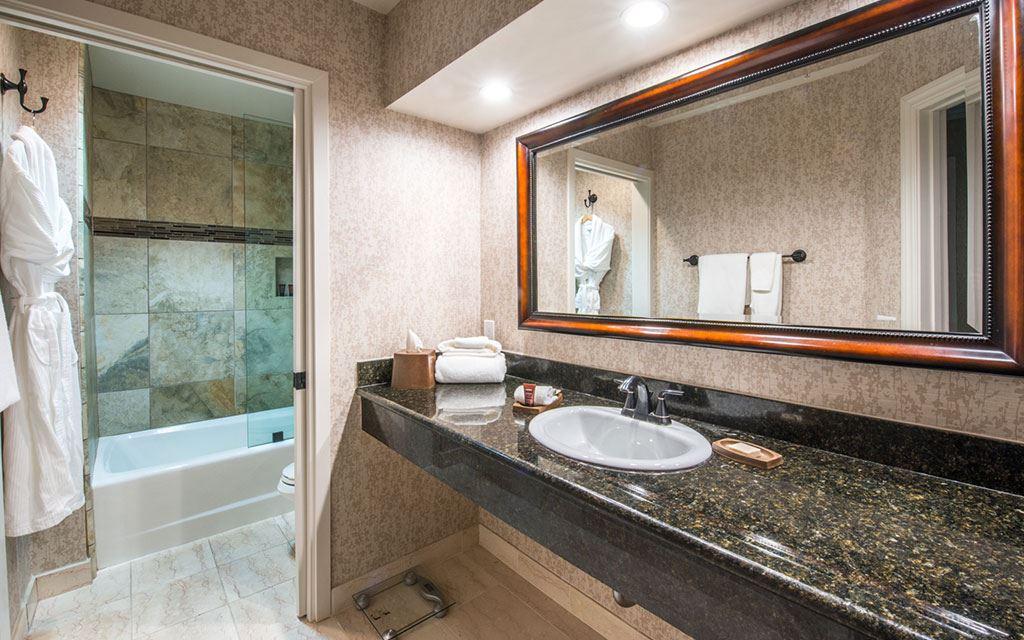 bathroom with single sink and glass bathtub/shower stall