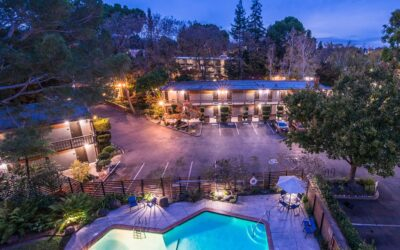 Aerial view of the hotel and outdoor swimming pool at night
