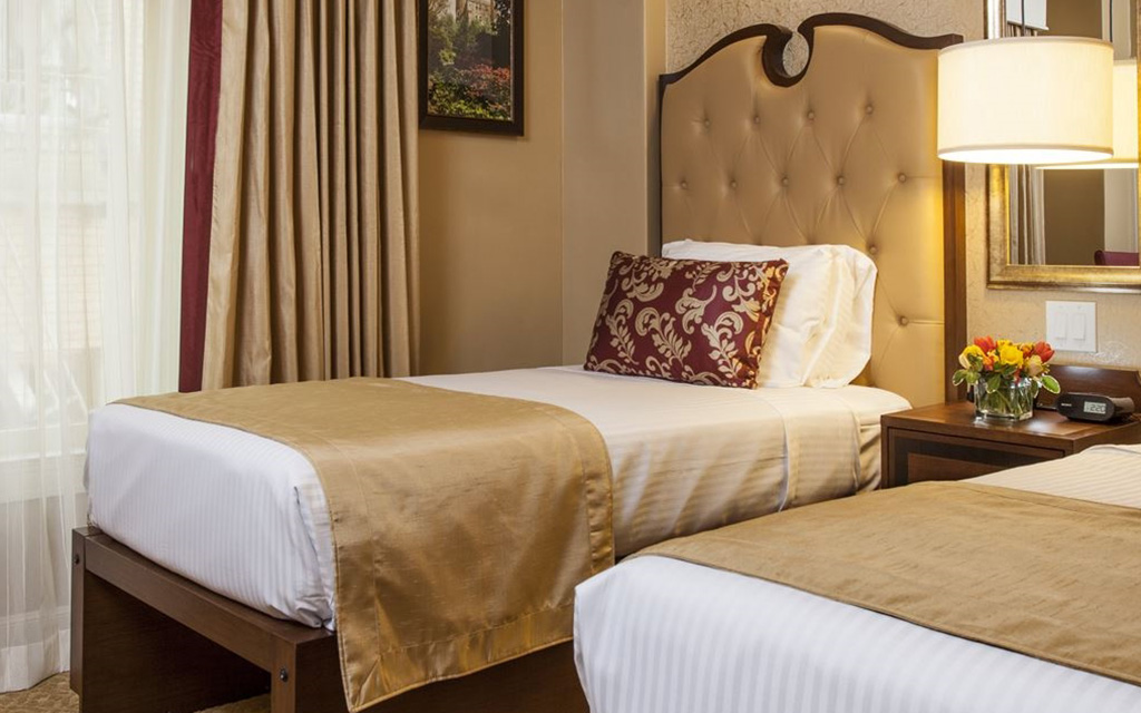 Large bed with plush headboard