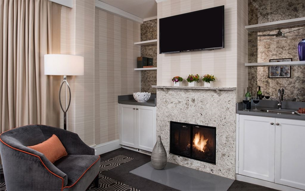 Velvet armchair by a hearth set into the wall