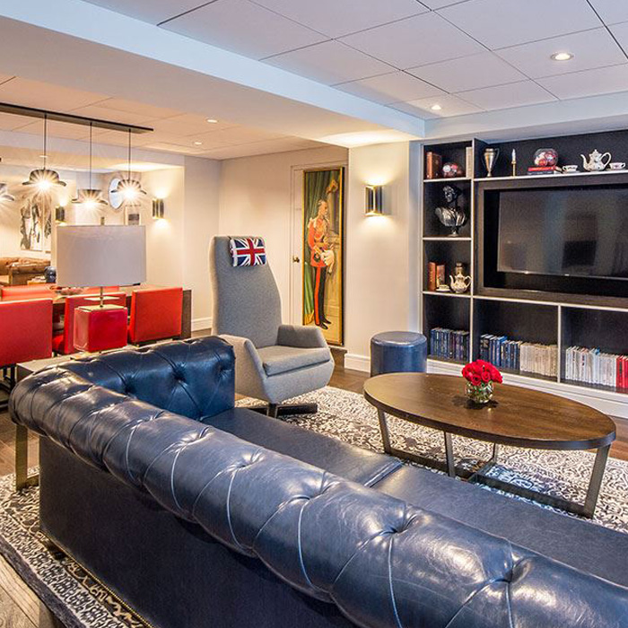 Couch and TV lounge space with a red, white, and blue theme