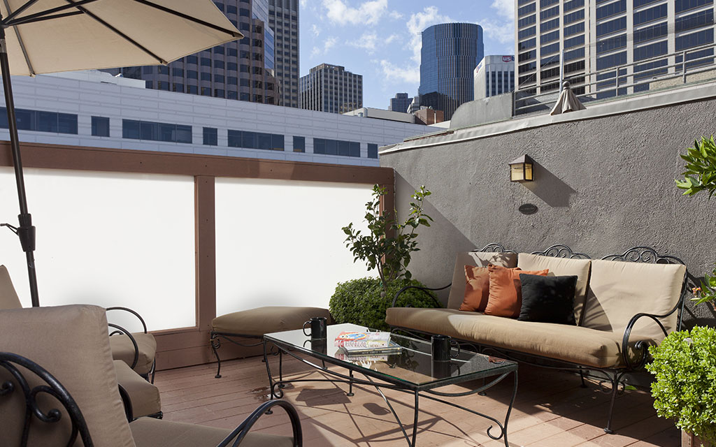 Walled outdoor patio space with deck furniture