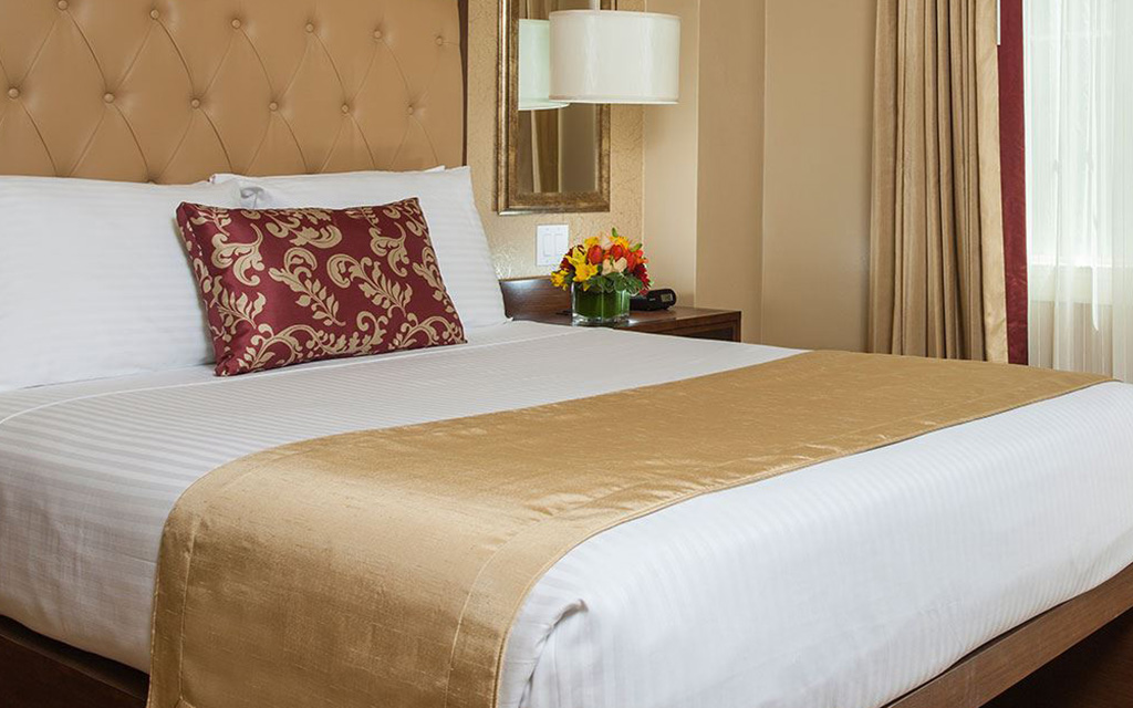Large bed with tall plush headboard