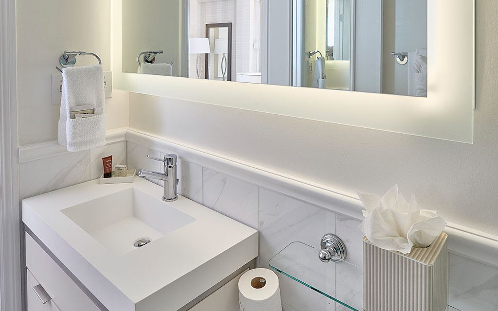 Large mirror above single-sink countertop