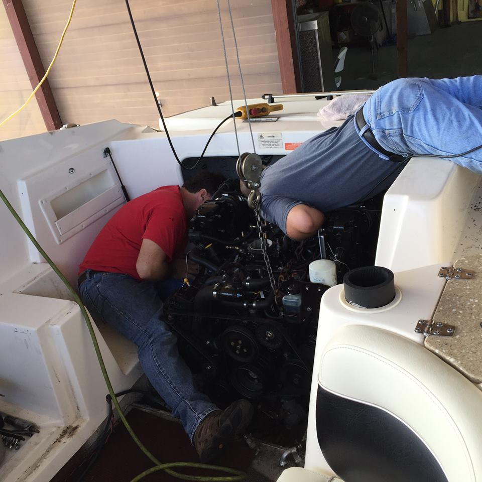 754f7b06-88ed-4910-8821-e0ec72d9c8acKen & Pat putting engine back in