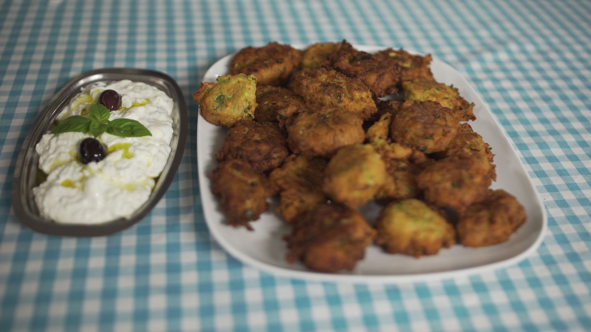 Photo of Zucchini Fritters with Tzatziki on plaid tablecloth
