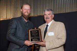 2016 Interior Finish Carpenter Apprentice of the Year Ryan Eiford is presented his award by WCIAF Chairman Ed Gittemeier.