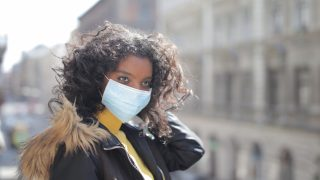 woman wearing black jacket and face mask