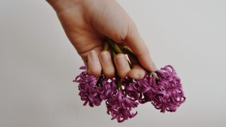 hand holding flowers