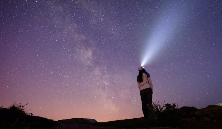 woman looking at the stars