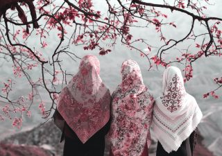 Girls in head scarves overlooking mountains