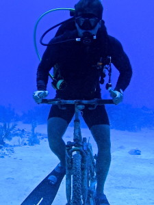 Grand Cayman riding a bike while diving