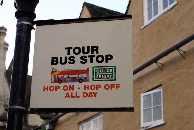 bigstock-Sign--Tour-Bus-Stop-Sign--1236002