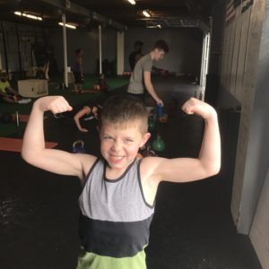 Little kid flexing his arms