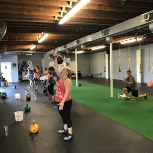 People working out with kettle bells