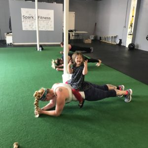 Woman and child working out