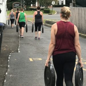 People walking with weight plates