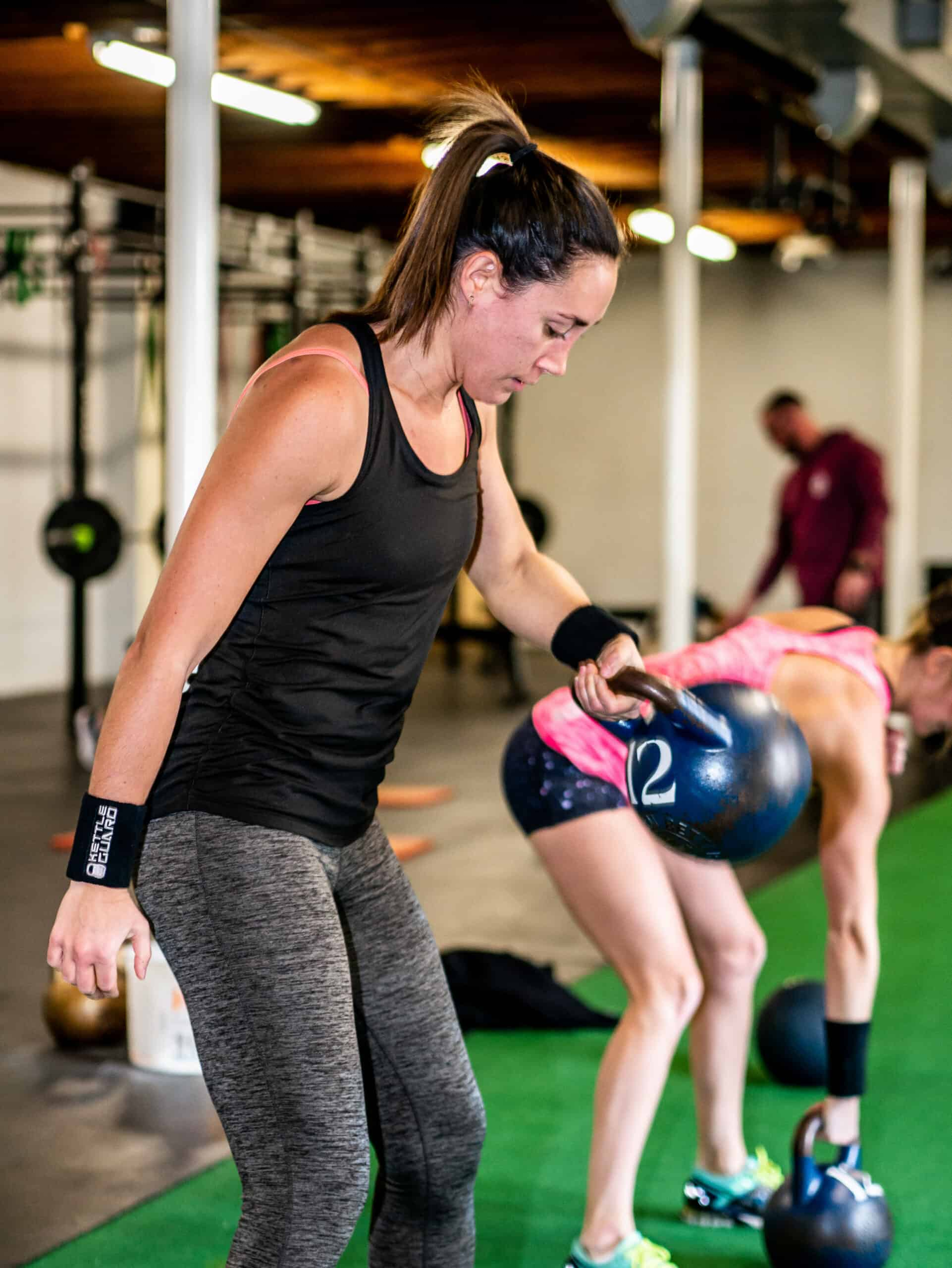 Spark Fitness members training with kettlebells at the fitness center